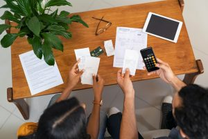 small business owners in Perth checking calculating their tax bills